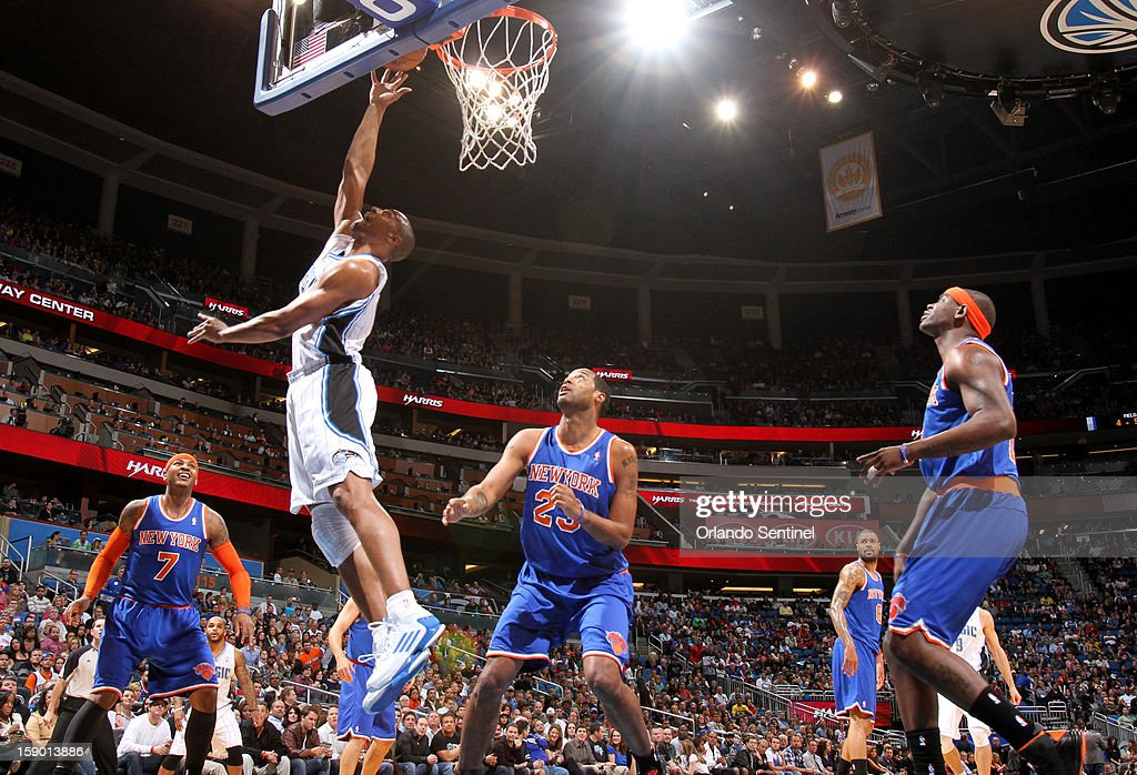 Orlando Magic guard Arron Afflalo (4) puts in a reverse layup against the New York Knicks in the first half at the Amway Center in Orlando, Florida, Saturday, January 5, 2013. The Knicks defeated the Magic, 114-106.