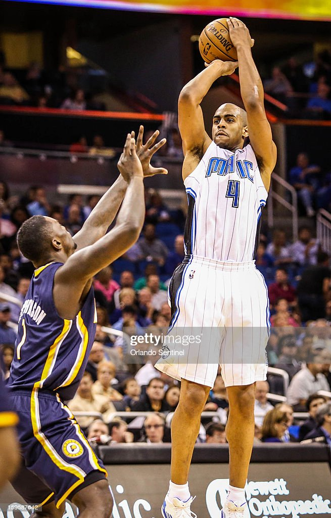 Orlando Magic guard Arron Afflalo (4) shoots over Indiana Pacers' Lance Stephenson (1) during second-quarter action at the Amway Center on Wednesday, January 16, 2013, in Orlando, Florida.