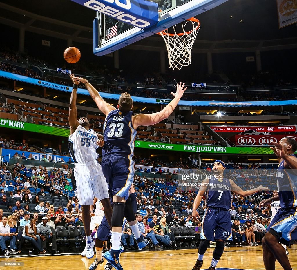Orlando Magic guard E'Twaun Moore (55) is blocked by Memphis Grizzlies defender Marc Gasol (33), as he goes up to the basket, during first-half action in a preseason game at Amway Center in Orlando, Florida, on Friday, October 18, 2013.