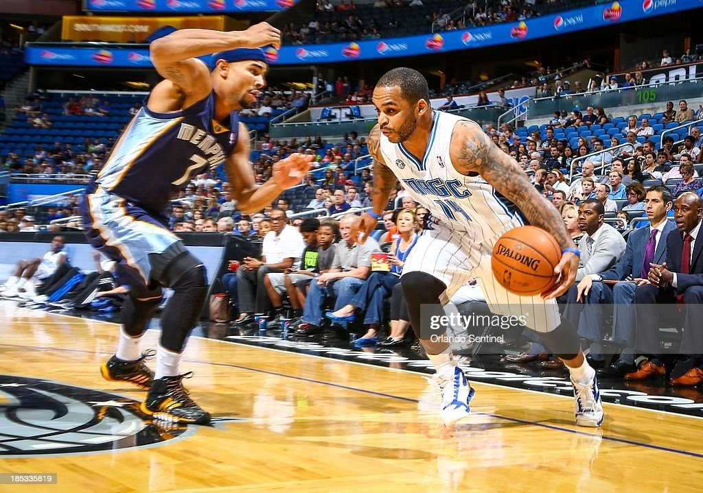 Orlando Magic guard Jameer Nelson (14) drives against the Memphis Grizzlies' Jerryd Bayless (7) during first-half action of a preseason game at the Amway Center in Orlando, Florida, on Friday, October 18, 2013.