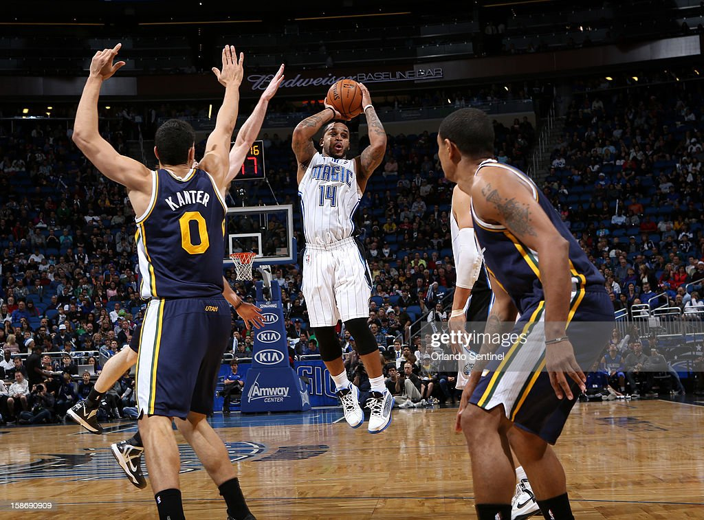 Orlando Magic guard Jameer Nelson looks for a teammate to pass to during their game against the Utah Jazz on Sunday, December 23, 2012, at the Amway Center in Orlando, Florida. The Utah Jazz defeated the Orlando Magic, 97-93.