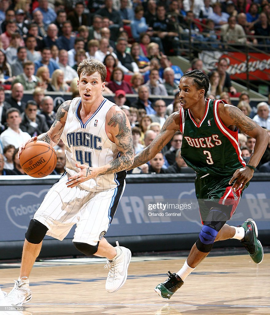 Orlando Magic guard Jason Williams dribbles around Milwaukee Bucks