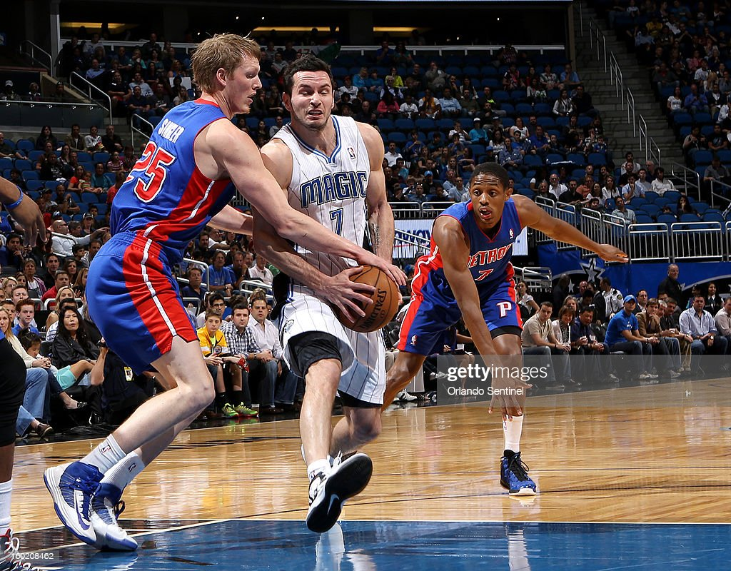 Orlando Magic guard J.J. Redick drives towards the basket while being guarded by Kyle Singler of the Detroit Pistons at the Amway Center in Orlando, Florida, Sunday, January 27, 2013. The Pistons won the game, 104-102.