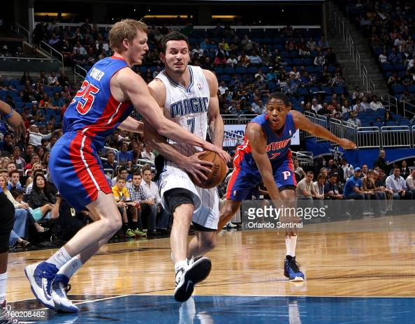 Orlando Magic guard JJ Redick drives towards the basket while being guarded by Kyle Singler of the Detroit Pistons at the Amway Center in Orlando...