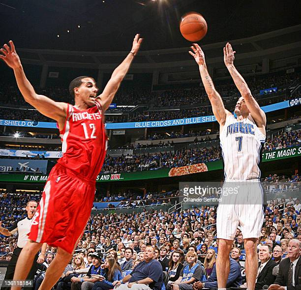 Orlando Magic guard JJ Redick shoots over Houston Rockets defender Kevin Martin during the first quarter at the Amway Center in Orlando Florida...