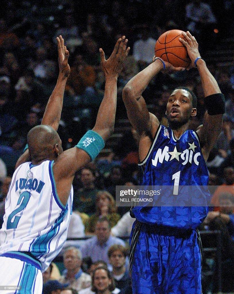 Orlando Magic guard Tracy McGrady R shoots over