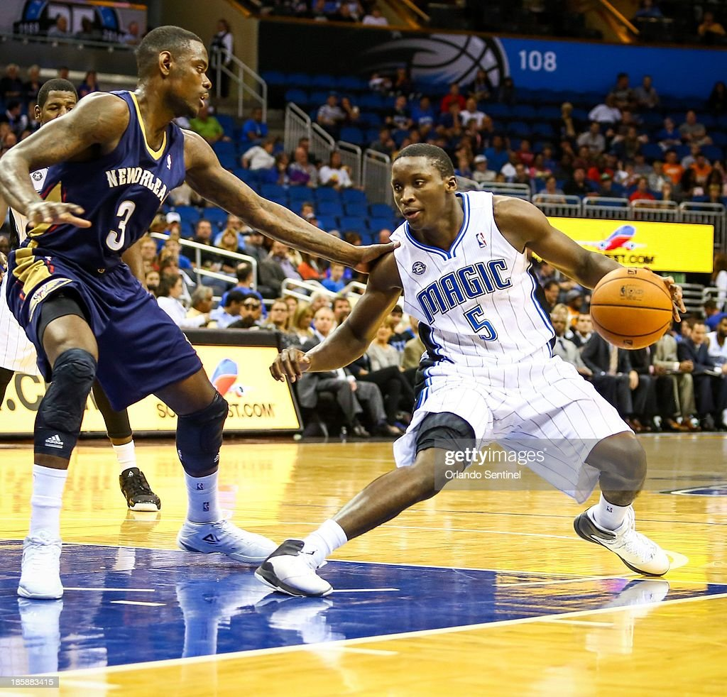 Orlando Magic guard Victor Oladipo (5) drives around the New Orleans Pelicans' Anthony Morrow (3) during the first half of a preseason game at the Amway Center in Orlando, Florida, Friday, October 25, 2013. The Pelicans beat the Magic 101-82.
