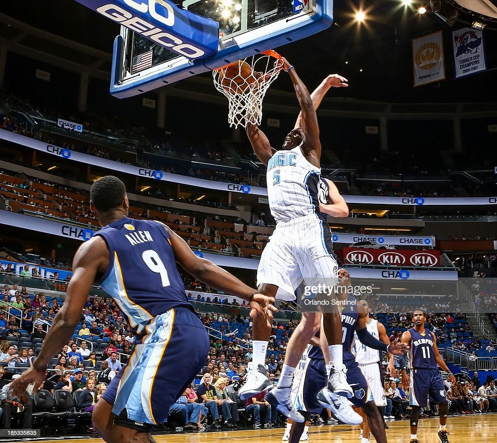 Orlando Magic guard Victor Oladipo (5) dunks the ball against the Memphis Grizzlies in the first half of a preseason game at the Amway Center in Orlando, Florida, on Friday, October 18, 2013.