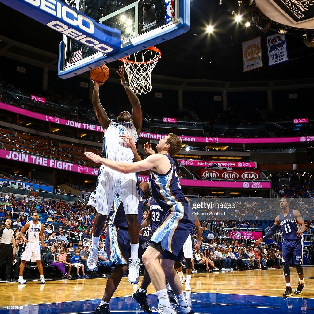 Orlando Magic guard Victor Oladipo (5) goes up to the basket against the Memphis Grizzlies in the first half of a preseason game at the Amway Center in Orlando, Florida, on Friday, October 18, 2013.