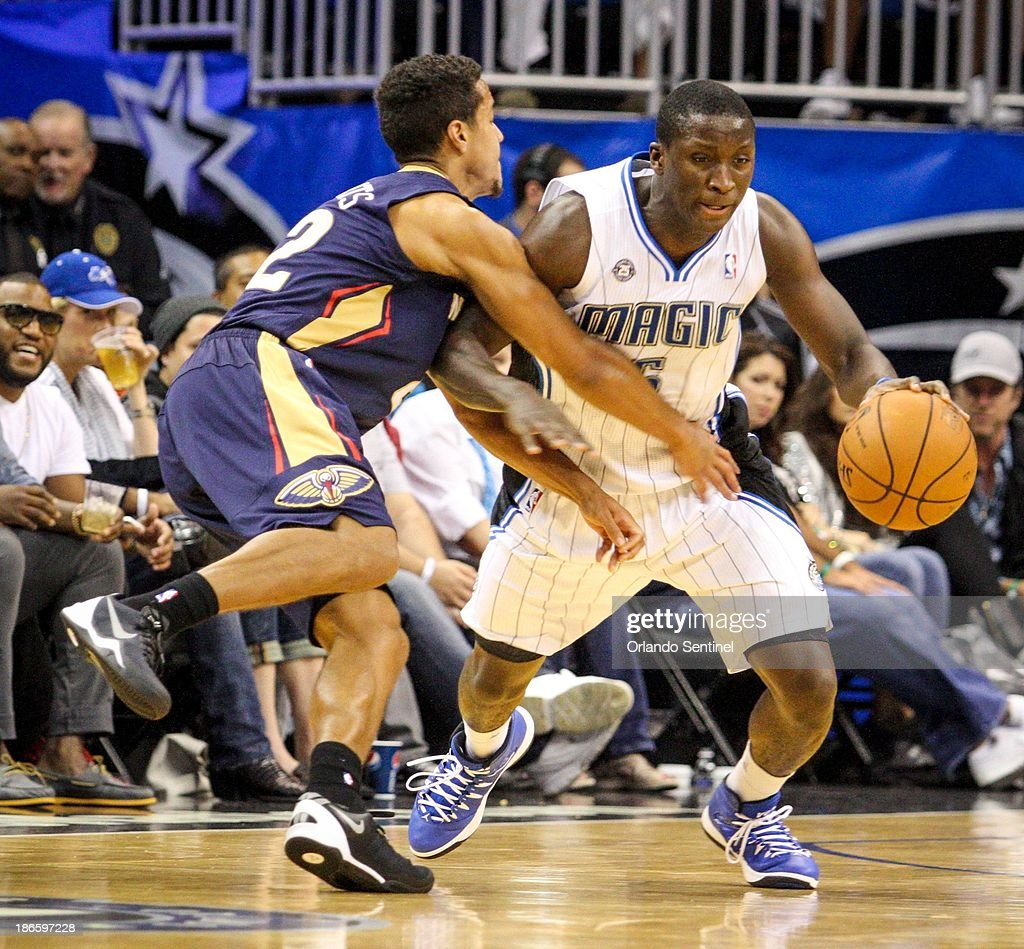 Orlando Magic guard Victor Oladipo steals the ball from the New Orleans Pelicans' Brian Roberts during secondhalf action at the Amway Center in...