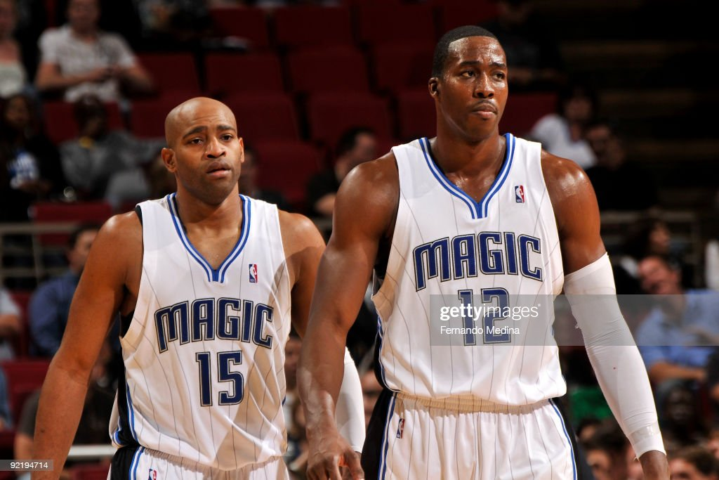 Orlando Magic guard <a gi-track='captionPersonalityLinkClicked' href=/galleries/search?phrase=Vince+Carter&family=editorial&specificpeople=201488 ng-click='$event.stopPropagation()'>Vince Carter</a> #15 and center <a gi-track='captionPersonalityLinkClicked' href=/galleries/search?phrase=Dwight+Howard&family=editorial&specificpeople=201570 ng-click='$event.stopPropagation()'>Dwight Howard</a> #12 during a pre-season game against the Indiana Pacers on October 21, 2009 at Amway Arena in Orlando, Florida.