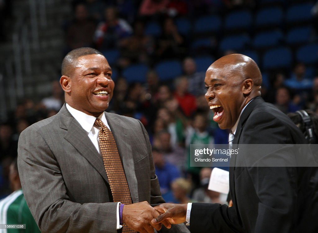 Orlando Magic head coach Jacque Vaughn, right, and Boston Celtics head coach Doc Rivers share a laugh before their game at the Amway Center on Sunday, November 25, 2012, in Orlando, Florida. The Celtics won the game 116-110.