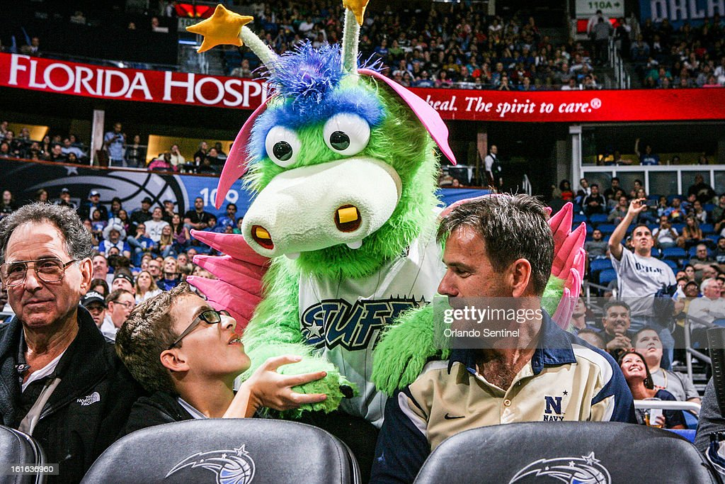 Orlando Magic mascot Stuff interacts with a fan during a game against the Atlanta Hawks at Amway Center in Orlando, Florida, on Wednesday, February 13, 2013. Atlanta defeated Orlando, 108-76.
