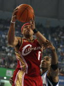 Orlando Magic player Dwight Howard tries to block Shannon Brown from the Cleveland Cavaliers during their NBA China Games 2007 exhibition basketball...