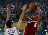 Orlando Magic player JJ Redick tries to block Shannon Brown from the Cleveland Cavaliers during their NBA China Games 2007 exhibition basketball...