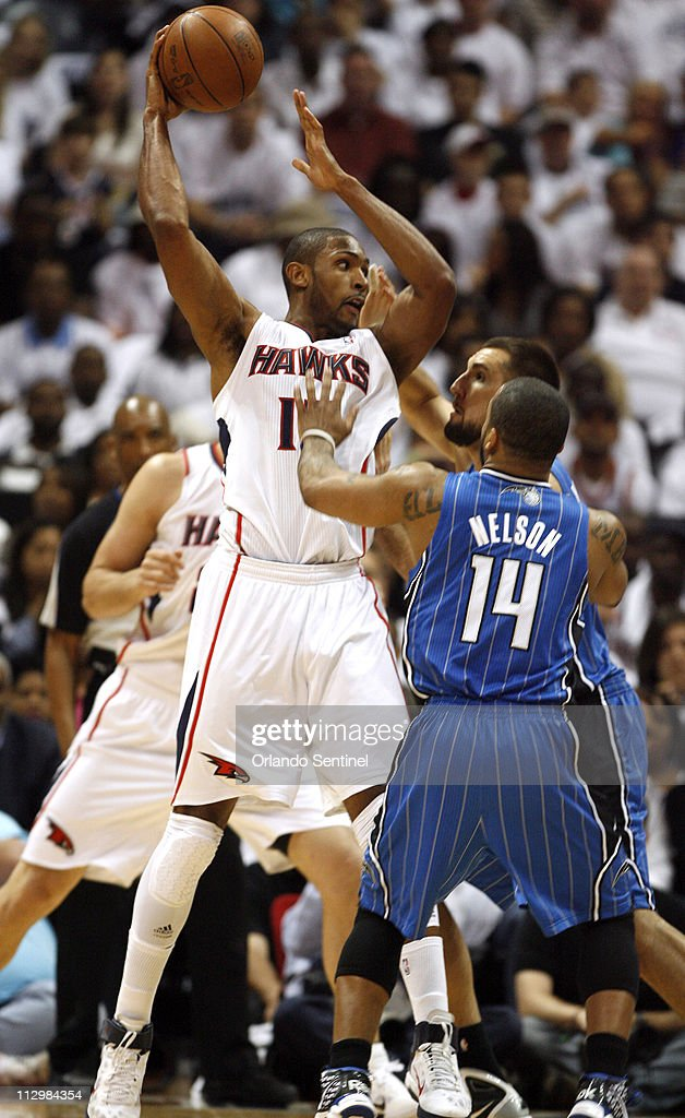Orlando Magic players Jameer Nelson (14) and Ryan Anderson guard the Atlanta Hawks' Al Horford during the first half of Game 3 of the NBA Eastern Conference Quarterfinals at Philips Arena in Atlanta, Georgia, Friday, April 22, 2011.