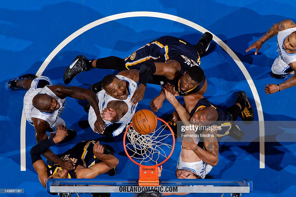 Orlando Magic players <a gi-track='captionPersonalityLinkClicked' href=/galleries/search?phrase=Jason+Richardson+-+Basketball+Player+-+Born+1981&family=editorial&specificpeople=201558 ng-click='$event.stopPropagation()'>Jason Richardson</a> #23, <a gi-track='captionPersonalityLinkClicked' href=/galleries/search?phrase=Glen+Davis+-+Basketball+Player&family=editorial&specificpeople=709385 ng-click='$event.stopPropagation()'>Glen Davis</a> #11 and Ryan Anderson #33 try for a rebound against Indiana Pacers players <a gi-track='captionPersonalityLinkClicked' href=/galleries/search?phrase=Roy+Hibbert&family=editorial&specificpeople=725128 ng-click='$event.stopPropagation()'>Roy Hibbert</a> #55, David West #21 and <a gi-track='captionPersonalityLinkClicked' href=/galleries/search?phrase=Danny+Granger&family=editorial&specificpeople=553769 ng-click='$event.stopPropagation()'>Danny Granger</a> #33 in Game Four of the Eastern Conference Quarterfinals during the 2012 NBA Playoffs on May 5, 2012 at Amway Center in Orlando, Florida.