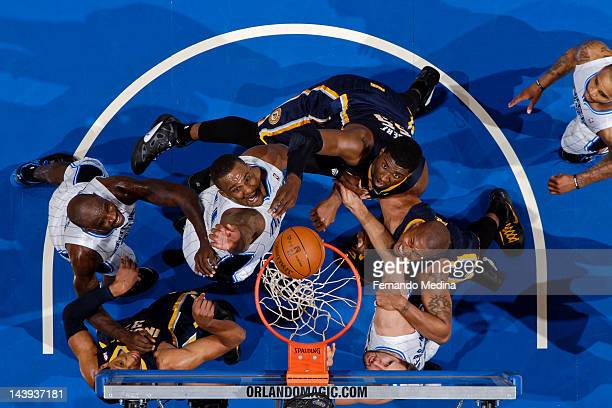Orlando Magic players Jason Richardson Glen Davis and Ryan Anderson try for a rebound against Indiana Pacers players Roy Hibbert David West and Danny...