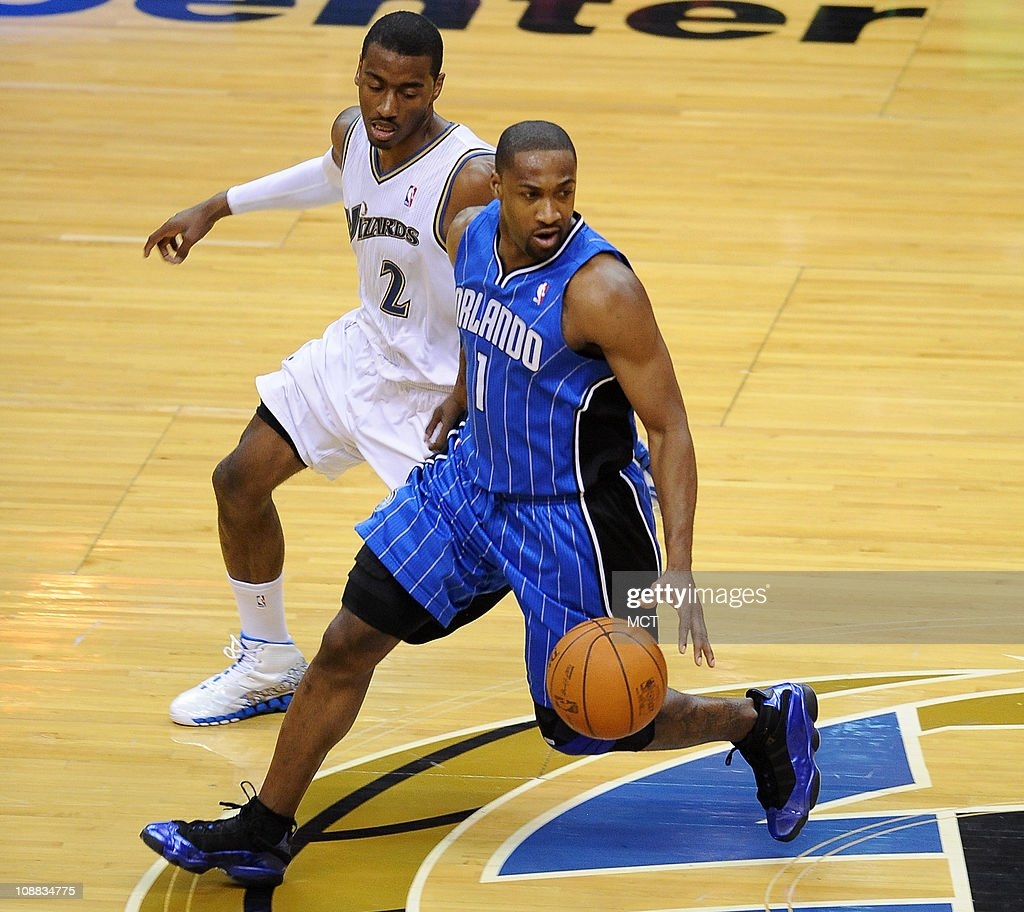 Orlando Magic point guard Gilbert Arenas (1) advances the ball across mid-court while defended by Washington Wizards point guard John Wall (2) during the fourth quarter The Magic defeated the Wizards, 110-92, at the Verizon Center in Washington, D.C., Friday, February 4, 2011.