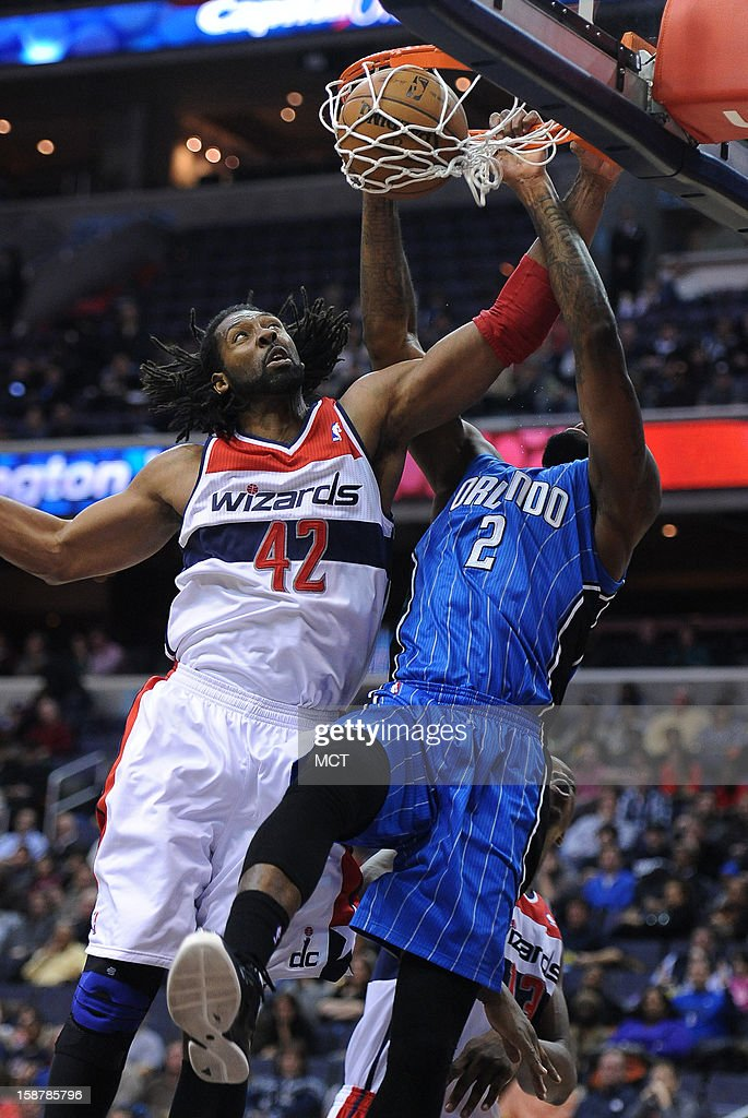 Orlando Magic power forward Kyle O'Quinn (2) dunks against Washington Wizards center Nene (42) in the first quarter at the Verizon Center in Washington, D.C., Friday, December 28, 2012.