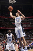 Orlando Magic power forward Ryan Anderson goes to the basket during an action against the Atlanta Hawks in Game Five of the Eastern Conference...