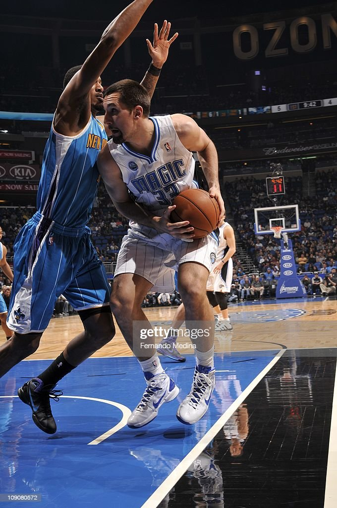 Orlando Magic power forward Ryan Anderson #33 protects the ball during the game against the New Orleans Hornets on February 11, 2011 at the Amway Center in Orlando, Florida. The Hornets won 99-93.