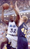 Orlando Magic's center Shaquille O'Neal is guarded by Indiana Pacers Rik Smits during first quarter action 23 May during game one of the Eastern...