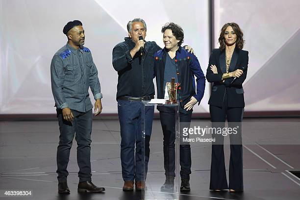 Orlando Morais Pascal Danae and Jean Lamoot from Riviere Noire receive the world music award for the album 'Riviere Noire' from Virginie Guilhaume...