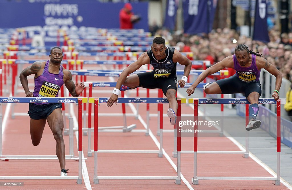 <a gi-track='captionPersonalityLinkClicked' href=/galleries/search?phrase=Orlando+Ortega&family=editorial&specificpeople=7863118 ng-click='$event.stopPropagation()'>Orlando Ortega</a> of Cuba (C) clears the last hurdle to win the men's 110 metres hurdles ahead of <a gi-track='captionPersonalityLinkClicked' href=/galleries/search?phrase=David+Oliver+-+Hurdler&family=editorial&specificpeople=4688316 ng-click='$event.stopPropagation()'>David Oliver</a> (L) of the United States and <a gi-track='captionPersonalityLinkClicked' href=/galleries/search?phrase=Aries+Merritt&family=editorial&specificpeople=538140 ng-click='$event.stopPropagation()'>Aries Merritt</a> of the United States (R) during the Great City Games on May 9, 2015 in Manchester, England.