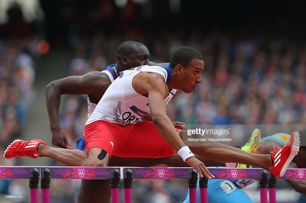<a gi-track='captionPersonalityLinkClicked' href=/galleries/search?phrase=Orlando+Ortega&family=editorial&specificpeople=7863118 ng-click='$event.stopPropagation()'>Orlando Ortega</a> of Cuba leads the pack as <a gi-track='captionPersonalityLinkClicked' href=/galleries/search?phrase=Shamar+Sands&family=editorial&specificpeople=4475420 ng-click='$event.stopPropagation()'>Shamar Sands</a> of the Bahamas falls over a hurdle in the Men's 110m Hurdles Round 1 Heats on Day 11 of the London 2012 Olympic Games at Olympic Stadium on August 7, 2012 in London, England.