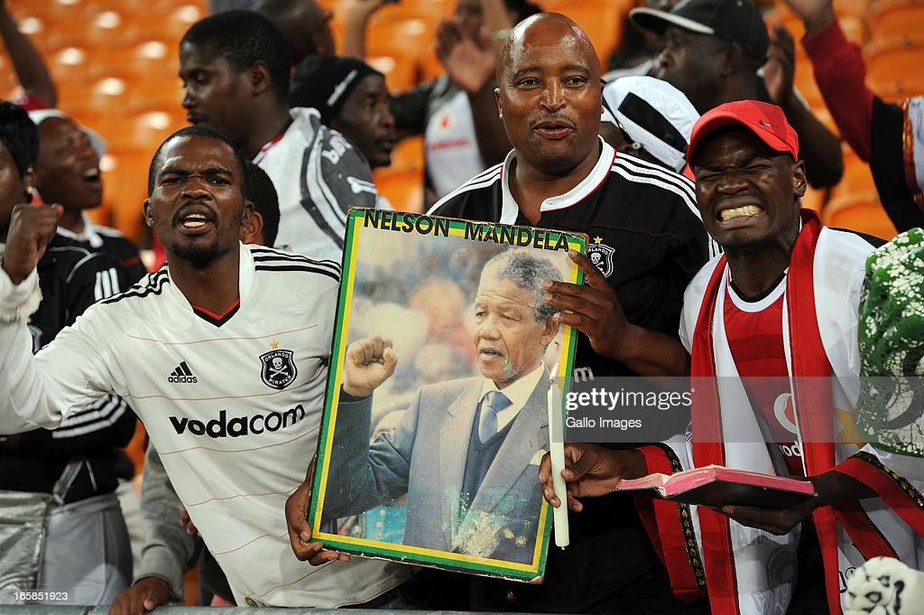 Orlando Pirates supporters carrying a poster of Nelson Mandela during the CAF Confedaration Cup match between Orlando Pirates and Zanaco at FNB Stadium on April 06, 2013 in Johannesburg, South Africa.