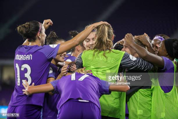 Orlando players celebrate with Orlando Pride forward Marta after she scored a goal during the NWSL soccer match between the Orlando Pride and Sky...