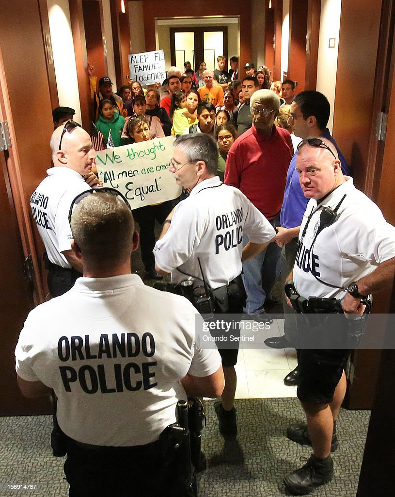 Orlando Police block the entrance in the hallway outside Sen. Marco Rubio's office as Hispanic immigration policy demonstrators arrived unannounced at Rubio's office in downtown Orlando, Thursday, January 3, 2012.