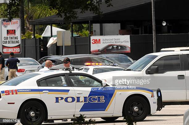 Orlando police officers seen outside at the main entrance of Pulse nightclub after a fatal shooting and hostage situation on June 12 2016 in Orlando...