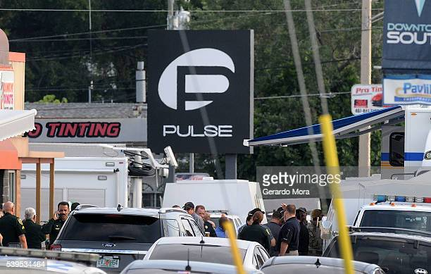 Orlando police officers seen outside of Pulse nightclub after a fatal shooting and hostage situation on June 12 2016 in Orlando Florida The suspect...