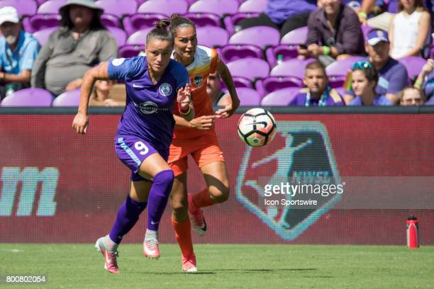 Orlando Pride defender Camila Pereira and Houston Dash defender Poliana Barbosa Medeiros go for the ball during the NWSL soccer match between the...