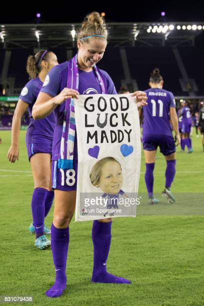 Orlando Pride defender Maddy Evans poses with a fan poster after the NWSL soccer match between the Orlando Pride and Sky Blue FC on August 12 2017 at...