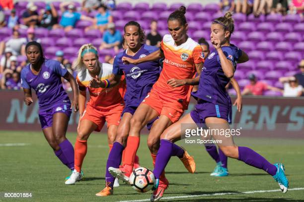 Orlando Pride defender Steph Catley and Houston Dash defender Poliana Barbosa Medeiros go for the ball during the NWSL soccer match between the...