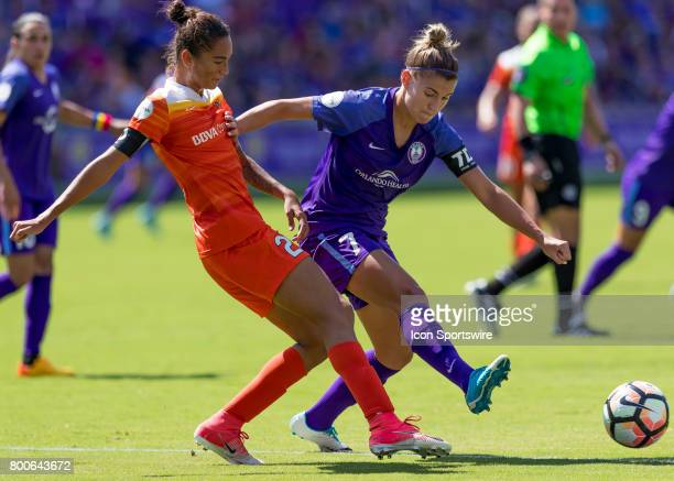 Orlando Pride defender Steph Catley blocks Houston Dash defender Poliana Barbosa Medeiros passduring the NWSL soccer match between the Orlando Pride...