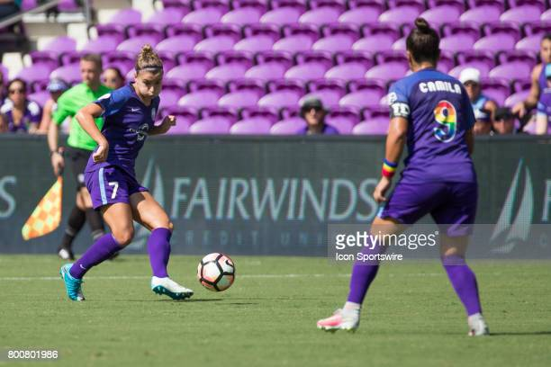 Orlando Pride defender Steph Catley passes the ball to Orlando Pride defender Camila Pereira during the NWSL soccer match between the Houston Dash...