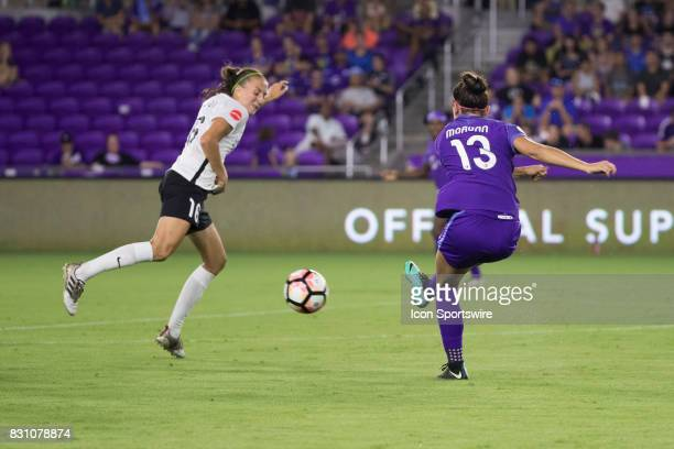 Orlando Pride forward Alex Morgan kicks the ball while Sky Blue FC midfielder Sarah Killion attempts to block it during the NWSL soccer match between...