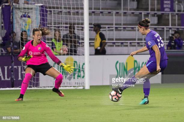 Orlando Pride forward Alex Morgan takes a shot on goal while Sky Blue FC goalkeeper Kailen Sheridan attempts to block it during the NWSL soccer match...
