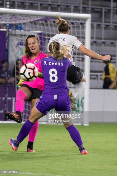 Orlando Pride forward Danica Evans takes a shot on goal but it is blocked by Sky Blue FC goalkeeper Kailen Sheridan during the NWSL soccer match...