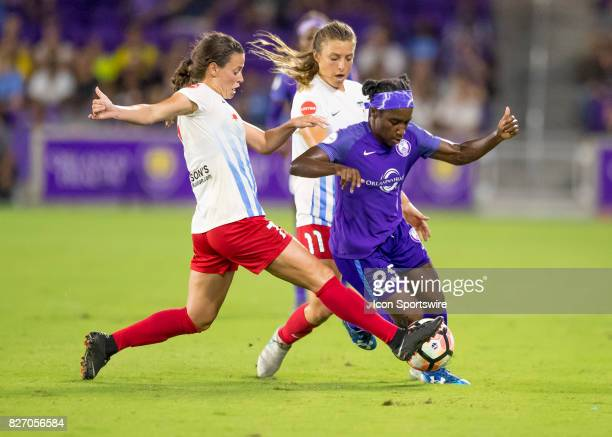 Orlando Pride forward Jasmyne Spencer gets fouled by Chicago Red Stars midfielder Taylor Comeau during the NWSL soccer match between the Orlando...