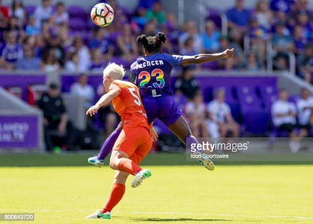 Orlando Pride forward Jasmyne Spencer goes up for a header verses Houston Dash defender Janine Van Wyk during the NWSL soccer match between the...