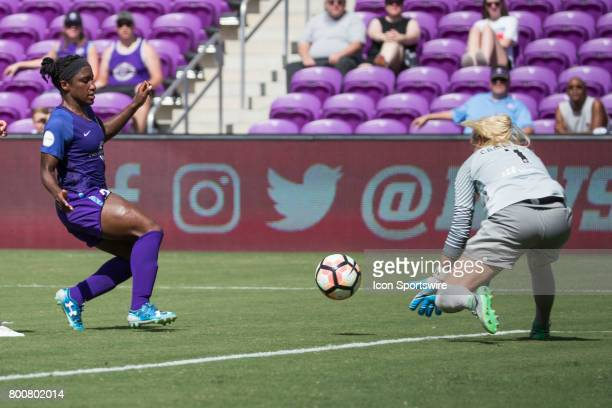 Orlando Pride forward Jasmyne Spencer takes a shot on goal and it is blocked by Houston Dash goalkeeper Jane Campbell during the NWSL soccer match...