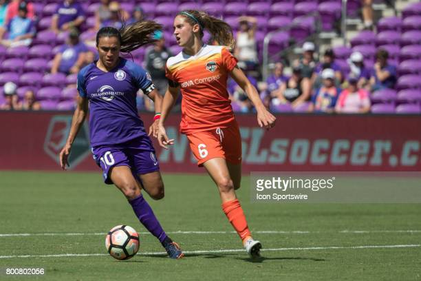 Orlando Pride forward Marta and Houston Dash midfielder Morgan Brian go for the ball during the NWSL soccer match between the Houston Dash and...