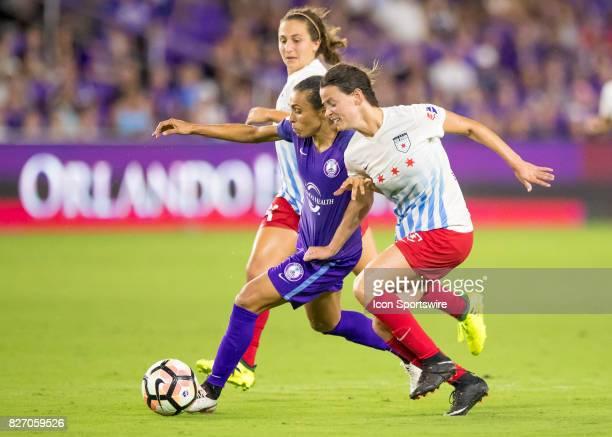 Orlando Pride forward Marta Vieira da Silva drives the ball towards goal verses Chicago Red Stars midfielder Taylor Comeau during the NWSL soccer...