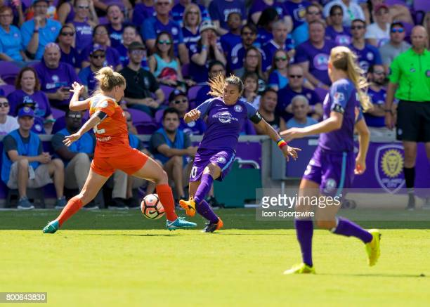 Orlando Pride forward Marta Viera da Silva challenges Houston Dash defender Camille Levin during the NWSL soccer match between the Orlando Pride and...