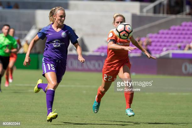 Orlando Pride forward Rachel Hill and Houston Dash defender Camille Levin chase the ball during the NWSL soccer match between the Houston Dash and...